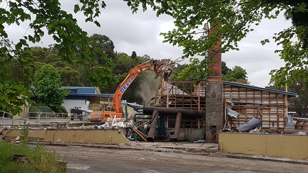 A building at the abandoned Melba College campus is demolished last year. Picture: Kiel Egging