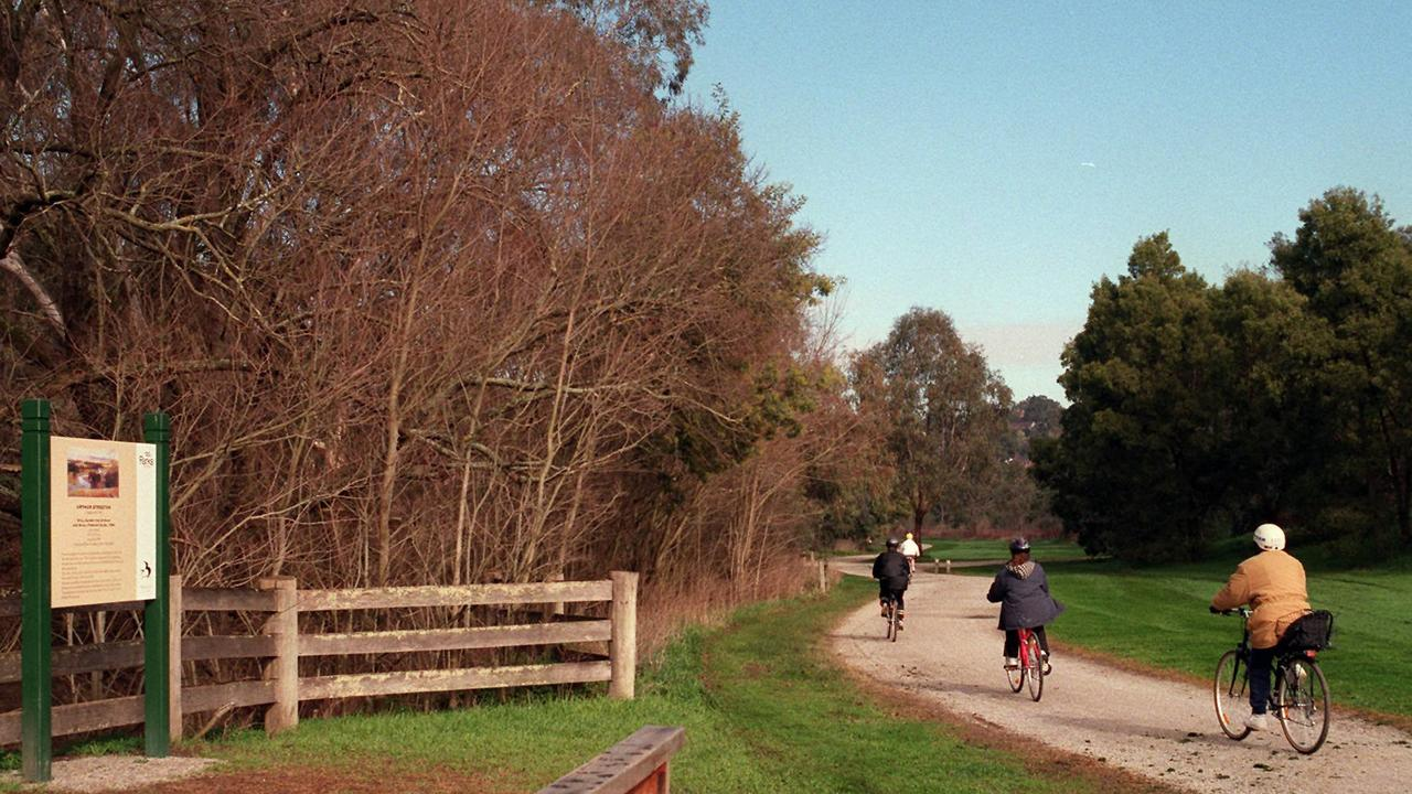 Cyclists travel along the Heidelberg School Artists Trail passing Arthur Streeton's